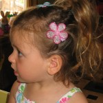two flowers and ponytail from side , 5 Toddler Flower Girl Hairstyles In Hair Style Category